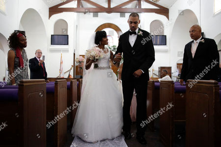 Jamie Nieto, Shevon Stoddart Two-time Olympic jumper Jamie Nieto, right, who was paralyzed from neck down 15 months ago after a spinal cord injury, walks down the aisle with his bride Shevon Stoddart after their wedding ceremony, in El Cajon, Calif. Step by halting step, Nieto made good on his vow to walk his new wife down the aisle of the church and out the door to a waiting limousine. It was roughly 130 steps, with a stop about halfway down the aisle for a kiss to appease the photographers. No cane, no walker, just his right arm holding onto his wife's left arm