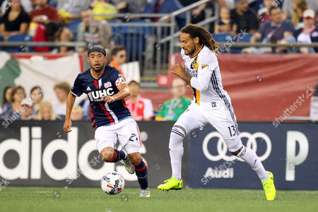 , 2017; Foxborough, MA, USA; New England Revolution midfielder Lee Nguyen (24) and Los Angeles Galaxy midfielder Jermaine Jones (13) in action during the first half of an MLS match between Los Angeles Galaxy and New England Revolution at Gillette Stadium. New England won 4-3