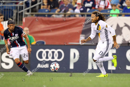 , 2017; Foxborough, MA, USA; Los Angeles Galaxy midfielder Jermaine Jones (13) and New England Revolution midfielder Lee Nguyen (24) sprints towards the ball during the first half of an MLS match between Los Angeles Galaxy and New England Revolution at Gillette Stadium. New England won 4-3