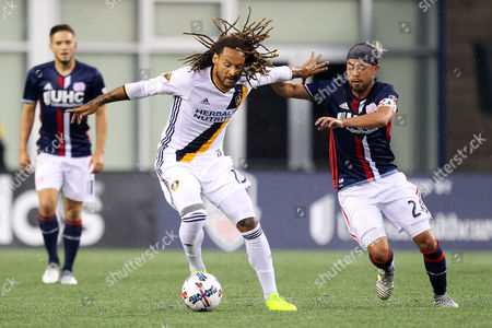 , 2017; Foxborough, MA, USA; New England Revolution midfielder Lee Nguyen (24) and Los Angeles Galaxy midfielder Jermaine Jones (13) battle for the ball during the first half of an MLS match between Los Angeles Galaxy and New England Revolution at Gillette Stadium. New England won 4-3