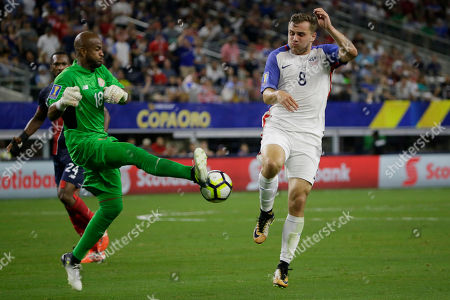 Patrick Pemberton, Paul Arriola Costa Rica goalkeeper Patrick Pemberton, left, and United States' Paul Arriolavie for the ball during a CONCACAF Gold Cup semifinal soccer match in Arlington, Texas