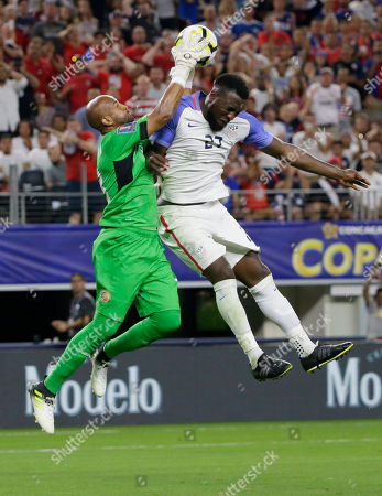 Patrick Pemberton, Jozy Altidore Costa Rica goalkeeper Patrick Pemberton, left, makes a save against United States' Jozy Altidore (27) during a CONCACAF Gold Cup semifinal soccer match in Arlington, Texas