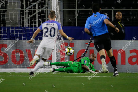 Costa Rica goalkeeper Patrick Pemberton, center, dives for the ball during a CONCACAF Gold Cup semifinal soccer match against United States in Arlington, Texas