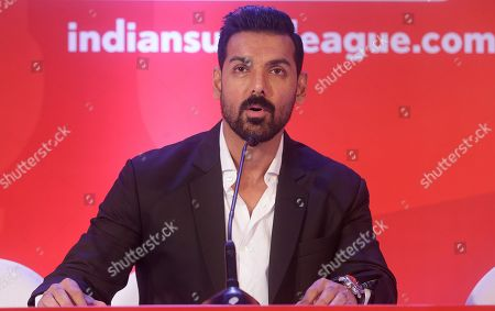 Indian Super League's (ISL) North East United FC owner and Bollywood actor John Abraham speaks with media during the player draft of the ISL in Mumbai, India