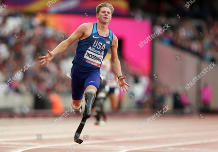 Hunter Woodhall of USA crosses the line to win gold for his team in the Mens 4x100m Relay T42-47.