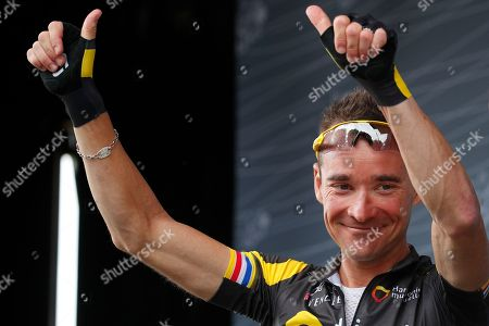 France's Thomas Voeckler greets spectators when signing the start list of the twenty-first and last stage of the Tour de France cycling race over 103 kilometers (64 miles) with start in Montgeron and finish in Paris, France