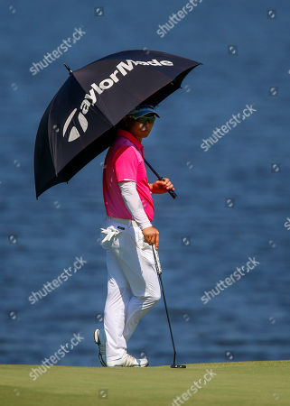 Y. E. Yang, of South Korea, waits to putt on the third hole in the final round of the Barbasol Championship golf tournament, in Opelika, Ala