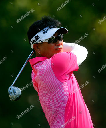 Y. E. Yang, of South Korea, tees off on the fourth hole in the final round of the Barbasol Championship PGA Tour golf tournament, in Opelika, Ala