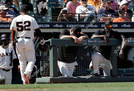 Bruce Bochy, Hensley Meulens, Miguel Gomez San Francisco Giants manager Bruce Bochy, center, and batting coach Hensley Meulens, right, stand in the dugout after Miguel Gomez (52) struck out against the San Diego Padres during the ninth inning of a baseball game in San Francisco