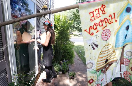 Democratic nominee for the House of Delegates 13th district seat, Danica Roem, leaves a brochure and a note as she canvasses a neighborhood, in Manassas, Va. Roem is running against Del. Bob Marshall in the 13th House of Delegates District