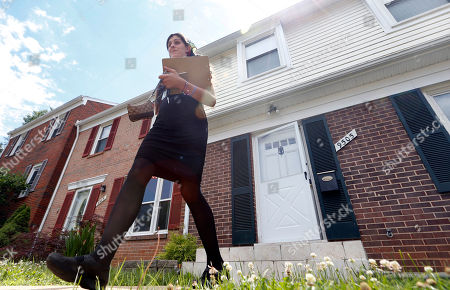 Democratic nominee for the House of Delegates 13th district seat, Danica Roem, walks from a home as she canvasses a neighborhood, in Manassas, Va. Roem handily won a four-way primary in June and is part of a surge of young, first-time candidates Democrats hope will help it retake control of the GOP-led chamber for the first time in nearly two decades