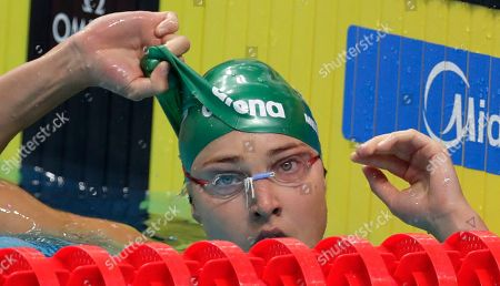 Lithuania's Ruta Meilutyte checks her time after a women's 100-meter breaststroke heat during the swimming competitions of the World Aquatics Championships in Budapest, Hungary