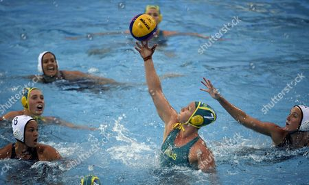 Stock Image of Kiley Neushul (L) and Makenzie Fischer (R) of the US challenge Rowie Webster of Australia for the ball during the women's water polo quarter final match between the USA and Australia at the 17th FINA Swimming World Championships in Budapest, Hungary, 24 July 2017.