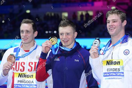 (L-R) Silver medal winner Kevin Cordes of Canada, gold medal winner Adam Peaty of the Great Britain and bronze medal winner Kirill Prigoda of Russia show their medals during the awarding ceremony of the men's 100-meter breaststroke final at the 17th FINA World Championships 2017 in Budapest, Hungary, 24 July 2017.