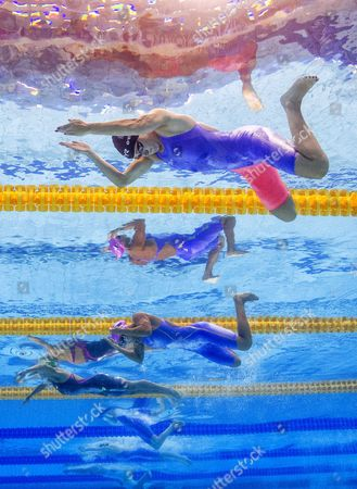 (From top) Siobhan O'Connor of Great Britain, Yuliya Efimova of Russia and Ruta Meilutyte of Lithuania compete in the women's 100m Breaststroke Heats during the Swimming competition held at the Duna Arena during the 17th FINA World Championships 2017 in Budapest, Hungary, 24 July 2017.