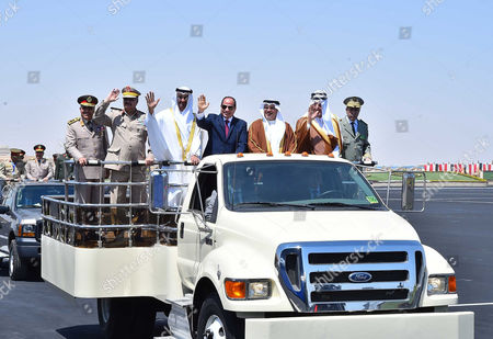 Egyptian President Abdel Fattah al-Sisi rides a vehicle with Arab leaders Sheikh Mohammed bin Zayed, Crown Prince of Abu Dhabi, Salman Bin Hamad Al Khalifa, Crown Prince of Bahrain, Prince Khalid Al-Faisal, Governor of Makkah Region, General Khalifa Haftar, commander in the Libyan National Army and members of the Egyptian military