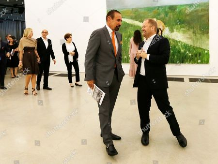 "Jorge M. Perez, Tobias Ostrander Jorge Perez, left, talks to Chief Curator Tobias Ostrander, right, at the Perez Art Museum Miami, in Miami. Ostrander said ""On the Horizon,"" includes more than 170 works"