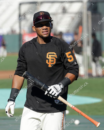 San Francisco Giants' Miguel Gomez during batting practice before a baseball game against the Pittsburgh Pirates in San Francisco