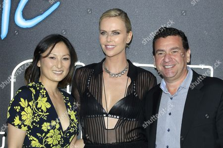 (L-R)  Producer Beth Kono, US actress/cast member Charlize Theron and producer AJ Dix arrive for the US premiere of 'Atomic Blonde' at The Theatre at Ace Hotel in Los Angeles, California, USA, 24 July 2017. The movie opens in the USA on 28 July 2017.