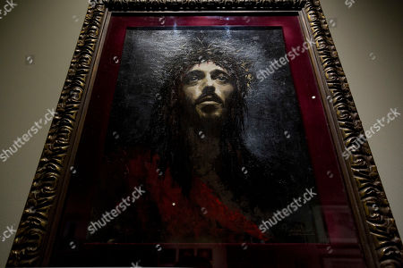 A painting depicting actor Robert Powell as seen in Franco Zeffirelli's 1977 film 'Jesus of Nazareth' is on display during a preview of the Franco Zeffirelli International Centre for the Performing Arts in the the late 17th century San Firenze Complex in Florence, . The center, besides its educational activities, brings together the entire artistic and cultural patrimony of the Italian director's almost 70-year career, including over ten thousand books from his personal library, thousands of professional documents and notes, designs, sketches, scripts, screenplays and storyboards, as well as a substantial collection of photographs of his works from the post-war years to present days. The center will open to the public on Sept. 1