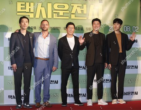 (L-R) South Korean director Jang Hoon,  German actor/cast member Thomas Kretschmann, South Korean actor/cast member Yoo Hae-jin, South Korean actor/cast member Song Kang-ho and South Korean actor/cast member Ryu Jun-yeol pose for photographs as they arrive for the event of vip premiere of movie 'A Taxi Driver' at the CCV Yongsan Cultureplex in Seoul, South Korea, 25 July 2017. The movie will open in South Korean theaters on 02 August.