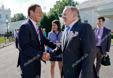 """Sean Spicer, Joe Piscopo Outgoing White House press secretary Sean Spicer, right, shakes hands with former """"Saturday Night Live"""" comedian and radio host Joe Piscopo, left, after doing a interview at the White House in Washington, . The White House is hosting a Regional Media Day with live radio and TV broadcasts from the White House Driveway with interviews with White House senior staff, Cabinet members and agency staffers"""