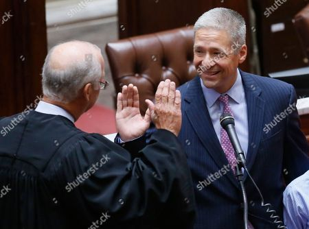 Michael Brooks, Douglas Combs Oklahoma state Senator-elect Michael Brooks, right, smiles as he is sworn-in by State Supreme Court Chief Justice Douglas Combs, left, on the Senate floor at the state Capitol in Oklahoma City