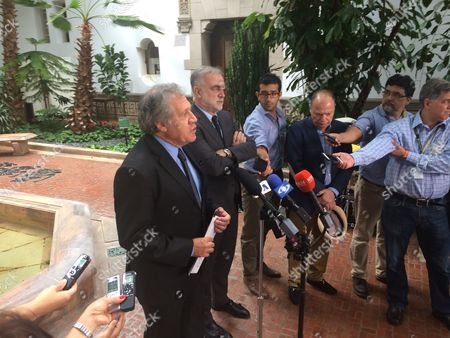 Stock Picture of Organization of American States (OAS) Secretary General Luis Almagro and the former prosecutor at the International Criminal Court Luis Moreno Ocampo participate in a news conference at OAS headquarters in Washington