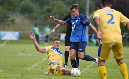 Ethan Phillips of Plymouth Parkway in hard on Damon Lathrope of Torquay United, during the pre season friendly match between Plymouth Parkway and Torquay United, on Tuesday 25th July 2017 at Bolitho Park Plymouth, Devon