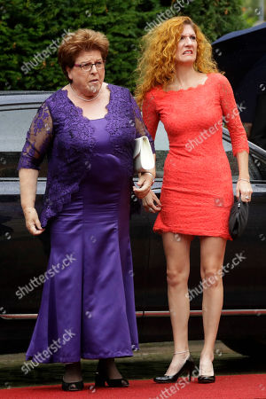 Bavarian Parliament president Barbara Stamm, left, and her daughter Sissi arrive for the opening of the Bayreuth Opera Festival in Bayreuth, Germany