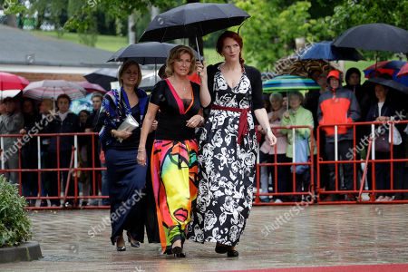 Dagmar Woehrl, left, member of the German Parliament, arrives for the opening of the Bayreuth Opera Festival in Bayreuth, Germany