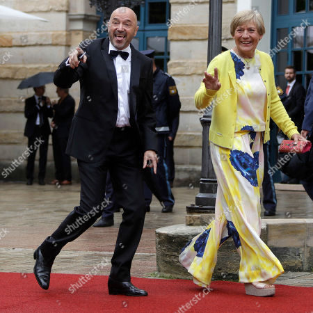 Alpin ski legends Rosi Mittermaier, right, and Christian Neureuther arrive for the opening of the Bayreuth Opera Festival in Bayreuth, Germany