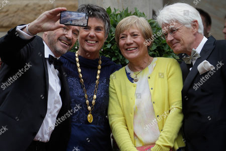 Alpin ski legends Rosi Mittermaier, 2nd right, and Christian Neureuther, left, take a selfie with Bayreuth's mayor Brigitte Merk-Erbe and husband Thomas Erbe prior to the opening of the Bayreuth Opera Festival in Bayreuth, Germany