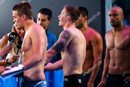 Adam Peaty of Great Britain is interviewed by Sharron Davies of the BBC after he wins Semifinal 2 of the Men's 50m Breaststroke and breaks his own World Record from the heats with a 25.95s to become the first Breaststroke swimmer in history to go sub 26s for the 50m.
