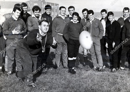 Clive Rowlands, Welsh Rugby Union Coach. Pictured Passing The Ball During A Training Session. The Players Are Ltor Phil Bennett Stuart Watkins John Taylor Hickey Denzil Williams Brian Price Gerald Davies Walter Williams Keith Jarrett Alan Skirving Barry John And Delme Thomas. Rowlands Later Became President Of The Welsh Rugby Union