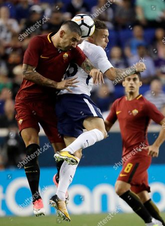 AS Roma's Aleksandar Kolarov, left, and Tottenham's Kieran Trippier go up for the ball during the first half of an International Champions Cup soccer match, in Harrison, N.J
