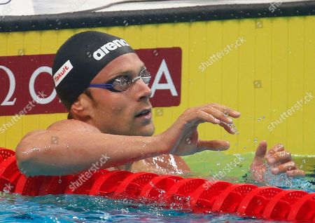 Stock Photo of Italy's Luca Dotto checks his time after a men's 100-meter freestyle heat during the swimming competitions of the World Aquatics Championships in Budapest, Hungary