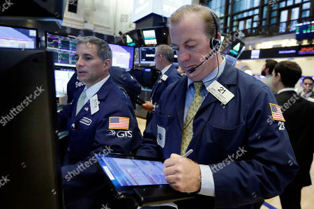 Stock Image of Anthony Rinaldi, James Doherty Specialist Anthony Rinaldi, left, and trader James Doherty work on the floor of the New York Stock Exchange, . Stocks are opening higher on Wall Street as several big companies including Boeing and AT&T report solid results