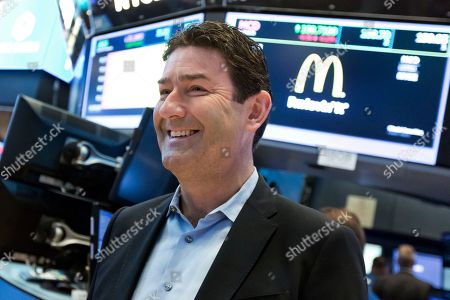 McDonald's CEO Steve Easterbrook visits the trading floor of the New York Stock Exchange, . Better than expected profits at U.S. companies like McDonald's and Caterpillar helped propel Wall Street to another record day Tuesday