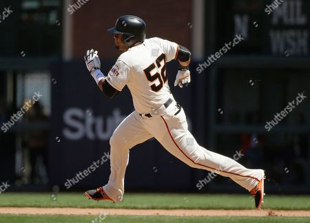 San Francisco Giants' Miguel Gomez runs for second base after hitting a double off Pittsburgh Pirates relief pitcher Tony Watson in the seventh inning of a baseball game, in San Francisco