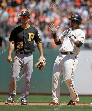 Adam Frazier, Miguel Gomez San Francisco Giants pinch-hitter Miguel Gomez, right, reacts after a double off Pittsburgh Pirates relief pitcher Tony Watson during the seventh inning of a baseball game, in San Francisco. At left is Pirates second baseman Adam Frazier. San Francisco won 2-1