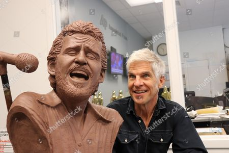 Stock Picture of Sculptor Kevin Kresse appears with a bust he created of the late musician Levon Helm, in Little Rock, Ark. The bust, once bronzed, will be part of a memorial to the performer, who grew up near Turkey Scratch in eastern Arkansas