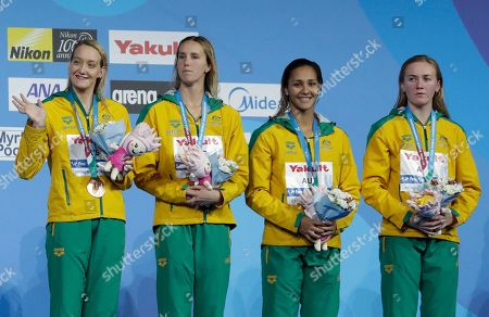 Stock Photo of Australia's bronze medal winners Madison Wilson, Emma McKeon, Kotuku Ngawati and Ariarne Titmus, from left, celebrate on the podium during the ceremony for the women's 4x200-meter freestyle final during the swimming competitions of the World Aquatics Championships in Budapest, Hungary