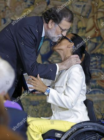 Spanish Prime Minister, Mariano Rajoy (L), grants the Gold Medal of Merit in Work to Spanish paralympic swimmer Teresa Perales during the Gold Medal of Merit in Work handover ceremony held at the Palace of la Moncloa in Madrid, Spain, 27 July 2017.