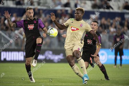 Diego Contento of Bordeaux (L) vies for the ball with Ezekiel Henry (C) of Videoton during the UEFA Europa League third qualifying round, first leg match between Girondins Bordeaux and Videoton FC , in Bordeaux, France, 27 July 2017.