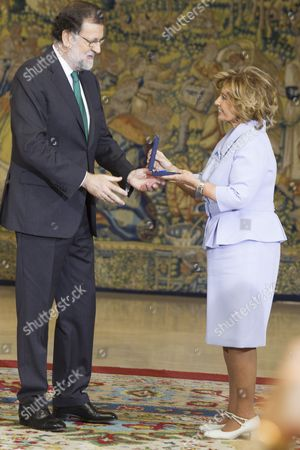 Spanish Prime minister Mariano Rajoy awards the Gold Medal of Merit to Maria Teresa Campos