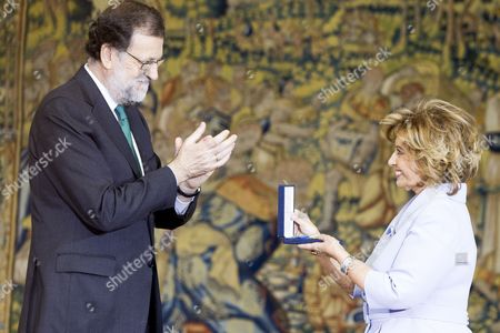 Spanish Prime minister Mariano Rajoy awards the Gold Medal of Merit to Maria Teresa Campos