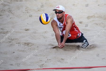 Michal Bryl of Poland in action during the first round match against Adrian Carambula, Alex Ranghieri of Italy of the Beach Volleyball World Championships 2017 at the Danube Island (Donauinsel) in Vienna, Austria, 28 July 2017.