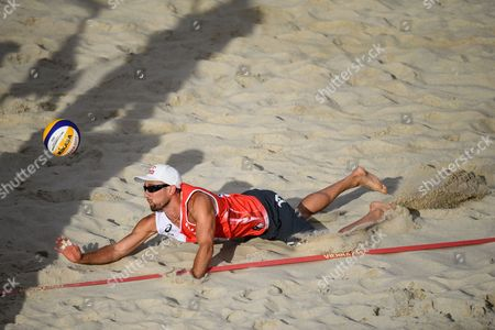 Grzegorz Fijaleka of Poland in action during the first round match against Adrian Carambula, Alex Ranghieri of Italy of the Beach Volleyball World Championships 2017 at the Danube Island (Donauinsel) in Vienna, Austria, 28 July 2017.