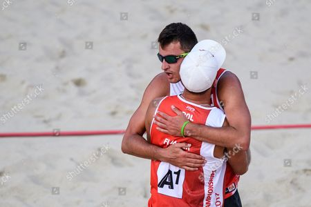Grzegorz Fijaleka (R) and Michal Bryl (L) of Poland celebrate winning the first round match against Adrian Carambula, Alex Ranghieri of Italy of the Beach Volleyball World Championships 2017 at the Danube Island (Donauinsel) in Vienna, Austria, 28 July 2017.